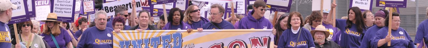 "A large crowd of SEIU members, all wearing purple, take up all lanes on a road, marching with banners and signs. Some signs read ""United for Oregon"", ""Share the Sacrifice"" and ""Don't cut services: Raise Corporate Minimum Tax""."