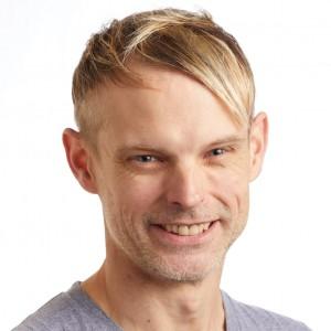 A smiling headshot portrait of SEIU member leader Benjamin Gerritz