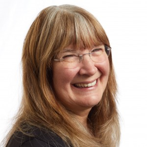A smiling headshot portrait of SEIU member leader Betty Holladay