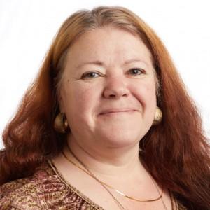 A smiling headshot portrait of SEIU member leader Bobbie Sotin