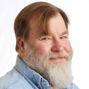 A smiling headshot portrait of SEIU member leader Dan Smith