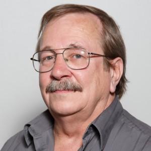 A smiling headshot portrait of SEIU member leader Keary DeBeck