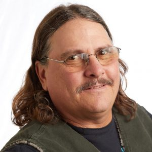 A smiling headshot portrait of SEIU member leader Mike Scott