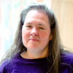 A smiling headshot portrait of SEIU member leader Rebecca Sandoval