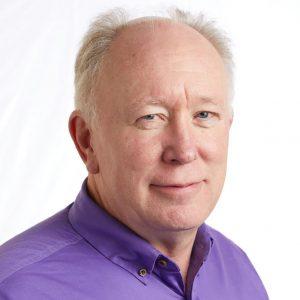 A smiling headshot portrait of SEIU member leader Steve Demarest