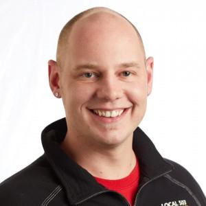 A smiling headshot portrait of SEIU member leader Taylor Bacon