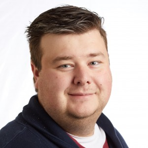 A smiling headshot portrait of SEIU member leader Blake Whitson