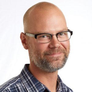 A smiling headshot portrait of SEIU member leader Dan Icklan