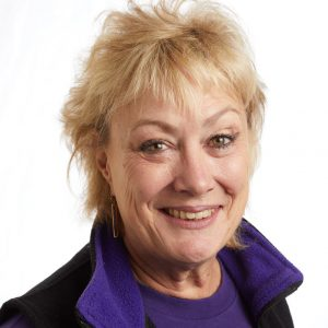 A smiling headshot portrait of SEIU member leader Debra Mitzel