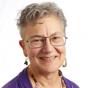 A smiling headshot portrait of SEIU member leader Diana Lobo
