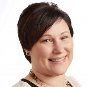A smiling headshot portrait of SEIU member leader Gina Mason