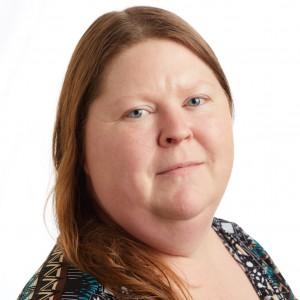 A smiling headshot portrait of SEIU member leader Kathleen Lamar