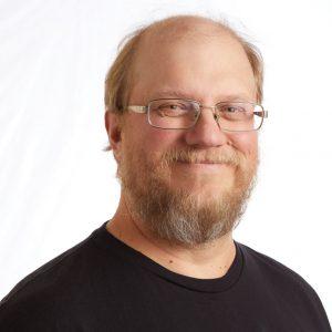 A smiling headshot portrait of SEIU member leader Shaun Notdurft
