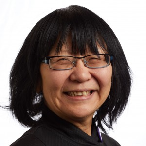 A smiling headshot portrait of SEIU member leader Theodora Ko Thompson
