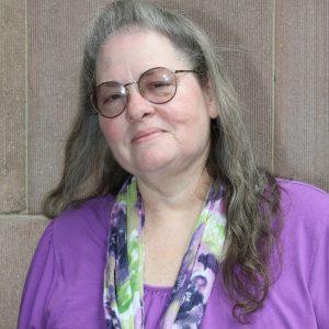 Un retrato sonriente en la cabeza de la líder miembro de SEIU, Rebecca Sandoval.