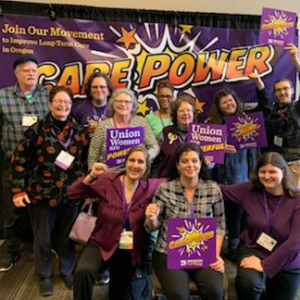Private agency homecare workers in front of 'Care Power' banner