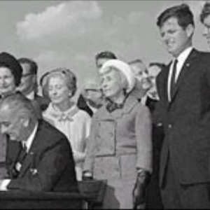 President Lyndon B. Johnson (center) signs the sweeping immigration bill of 1965 into law at a ceremony on Liberty Island, Oct. 4, 1965.